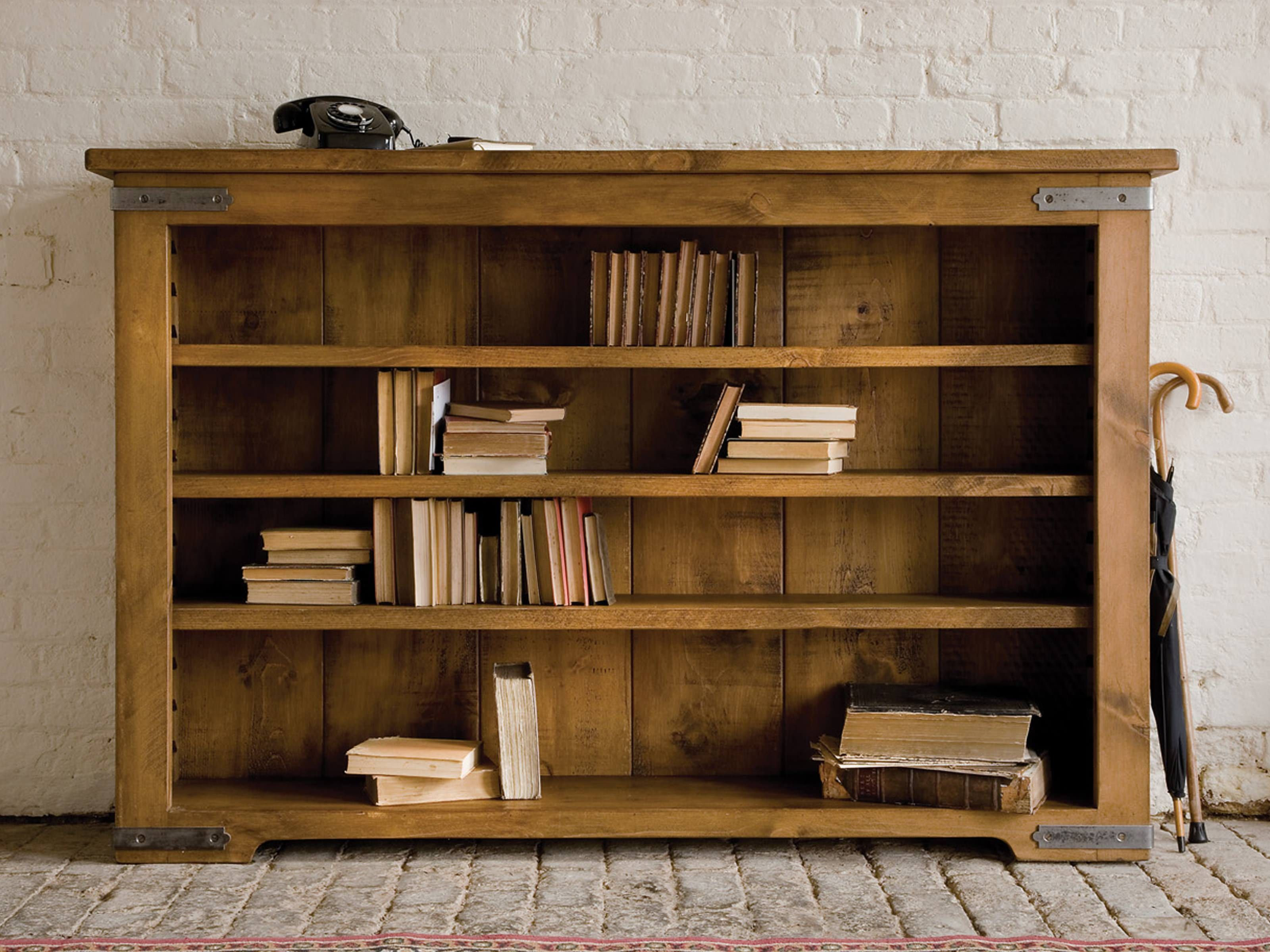 terrific unfinished oak low bookcase over stones floors and white subway brick wall panels as inspiring