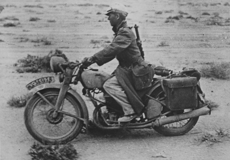 306bb0d8 Soldier Afrika Korps Wehrmacht motorbike Puch 350 GS in the area of  El-Sollum. The soldier armed with a submachine gun Steyr-Solothurn S1-100,  ...
