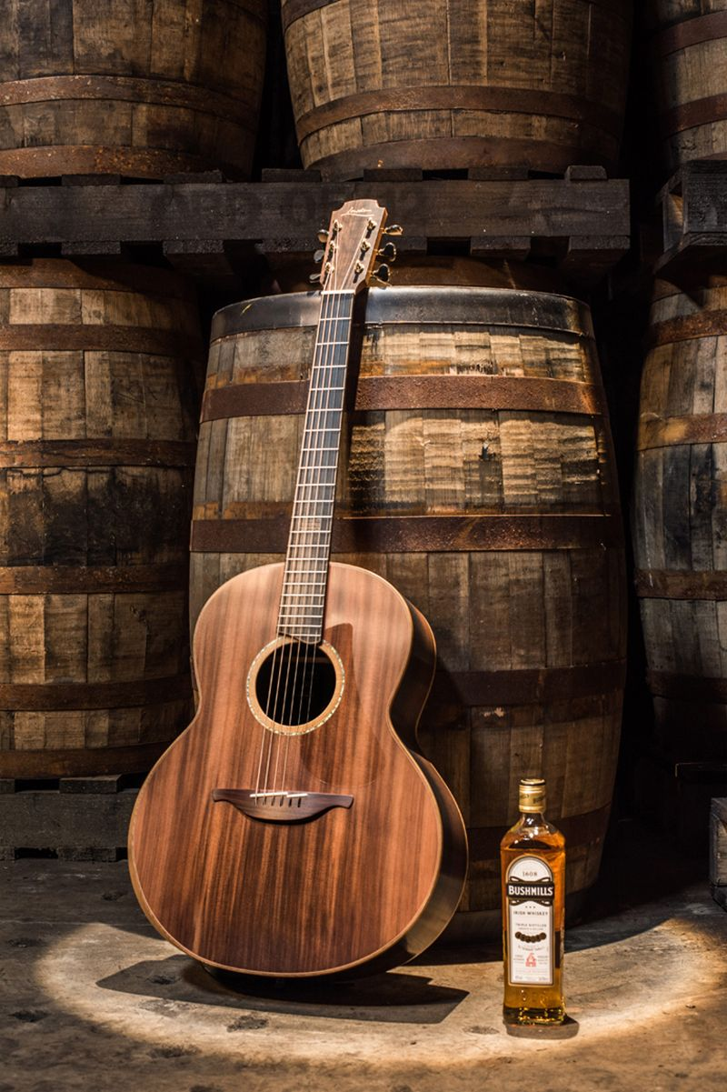 Lowden Bushmills Guitar Made From Whiskey Barrels And Bogwood Acoustic Guitar Photography Vintage Guitars Acoustic Guitar