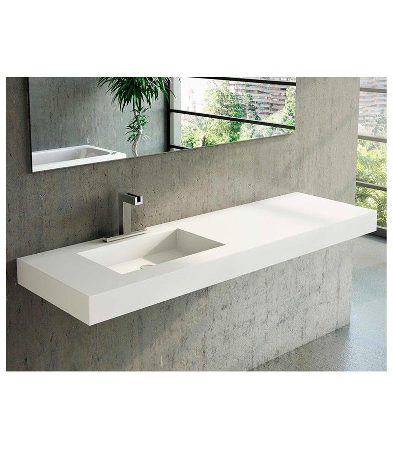 lavabo encimera de un seno desplazado con faldón fabricado en solid - baos con mosaicos