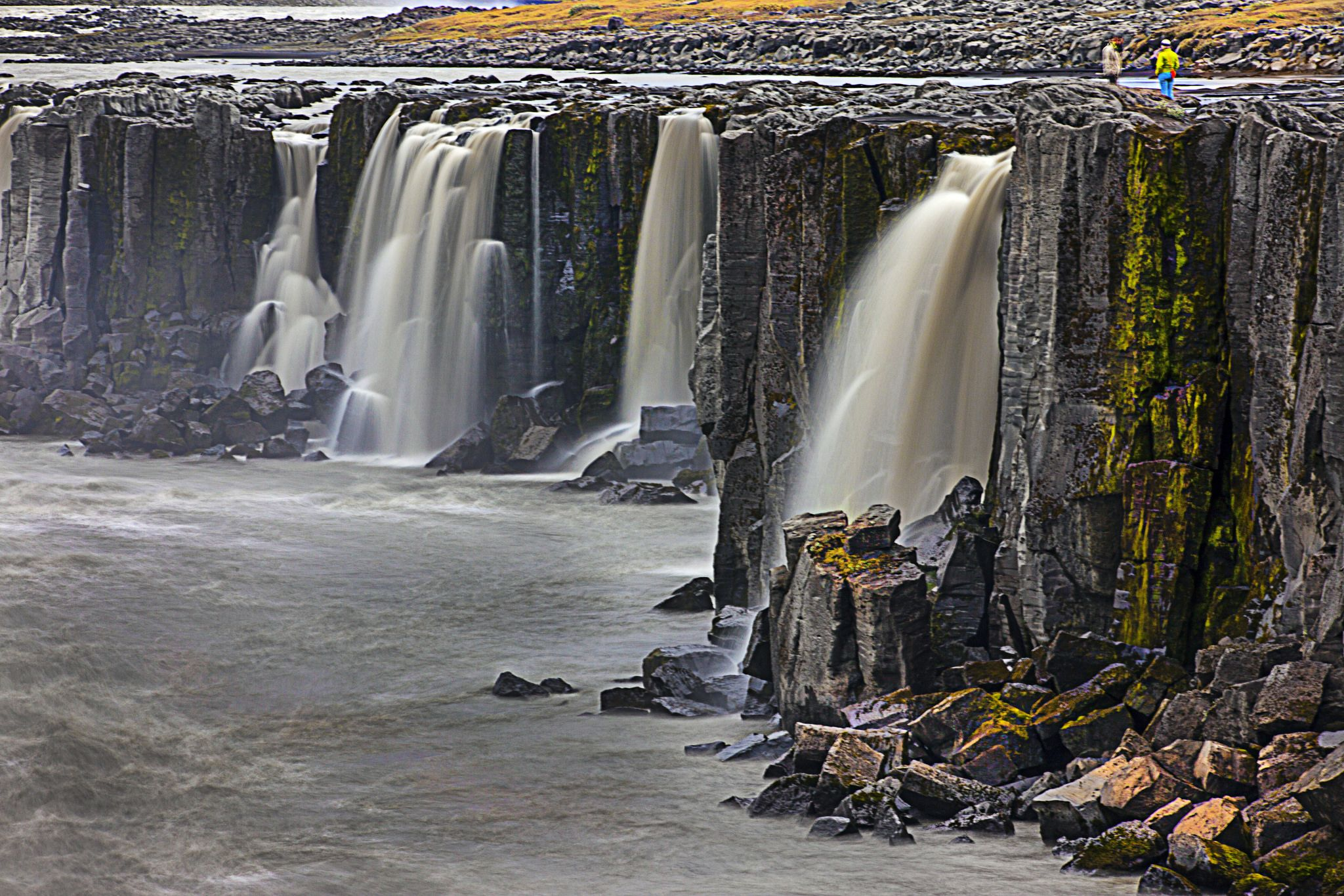 https://flic.kr/p/pSdryC | Selfoss Waterfall - Iceland | Selfoss is a waterfall in the river Jökulsá á Fjöllum in the north of Iceland which drops over some waterfalls about 30 km before flowing into Öxarfjörður, a bay of the Arctic Sea. A few hundred meters downstream of the Selfoss waterfall (11 m high), the Dettifoss waterfall is situated, the most powerful waterfall of Europe.