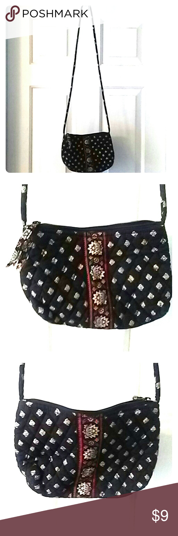 Vera Bradley purse A small Vera Bradley mini shoulder purse. It's black, tan, red and a darker blue or green color. Has small flowers everywhere and in the middle on each side 2 red stripes with 4 larger flowers going down the middle. The inside is dark red. The strap is about 46 inches long. The purse is about 9 inches across and 6 1/2 inches tall. Smoke free home. Vera Bradley Bags Mini Bags