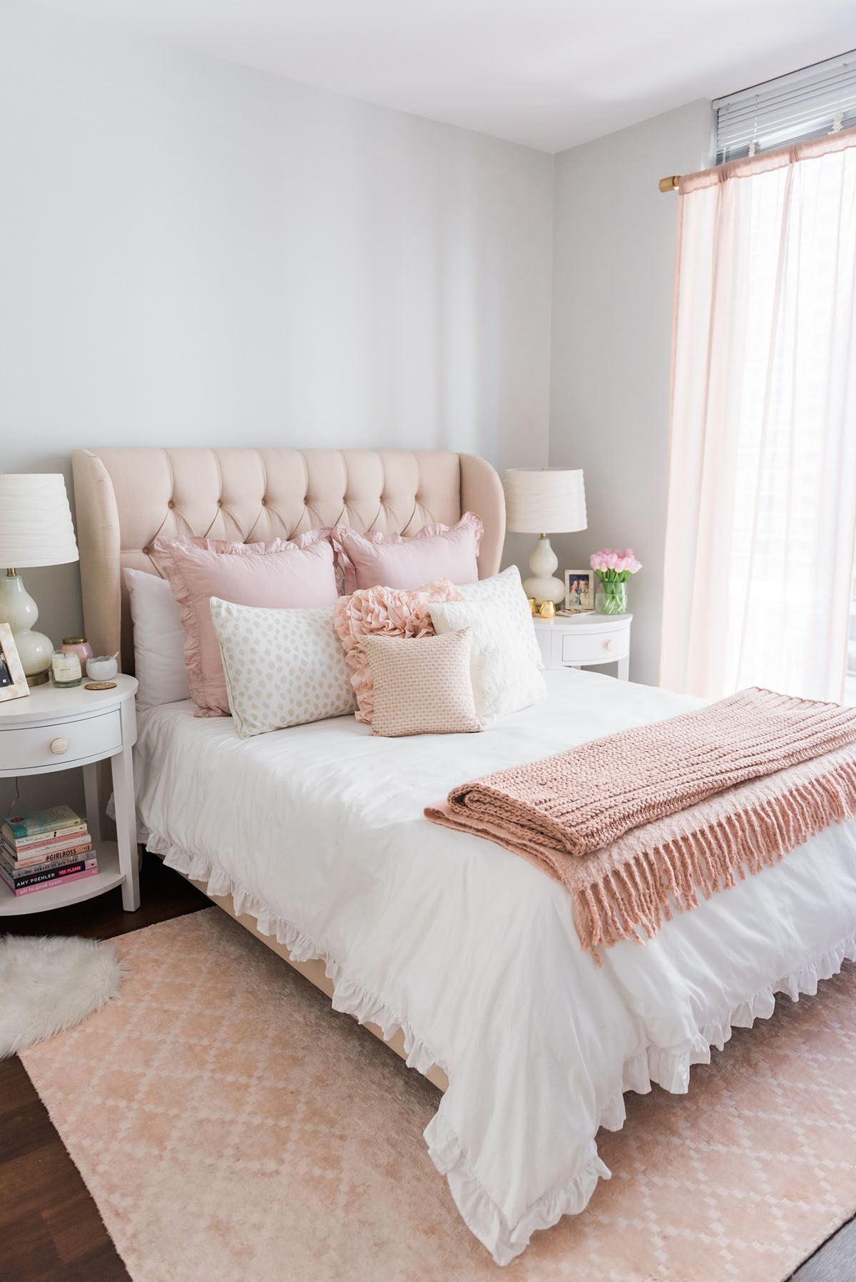 Blogger Jessica Sy Of Bows Sequins Shares Her Chicago Parisian Chic Bedroom Design Tufted Headboard Blush Pink Rug And White Ruffled Bedding