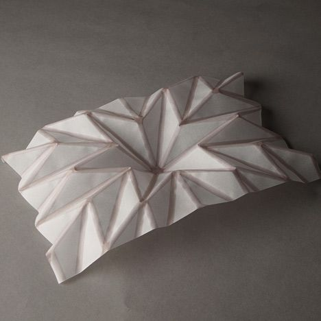 Hydro-fold by Christophe Guberan. Adapted an inkjet printer to print patterns that contort pieces of paper into 3D forms
