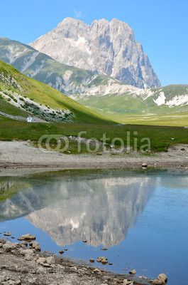 The reflect of the Gran Sasso mountain on the lake - Abruzzo - Italy.