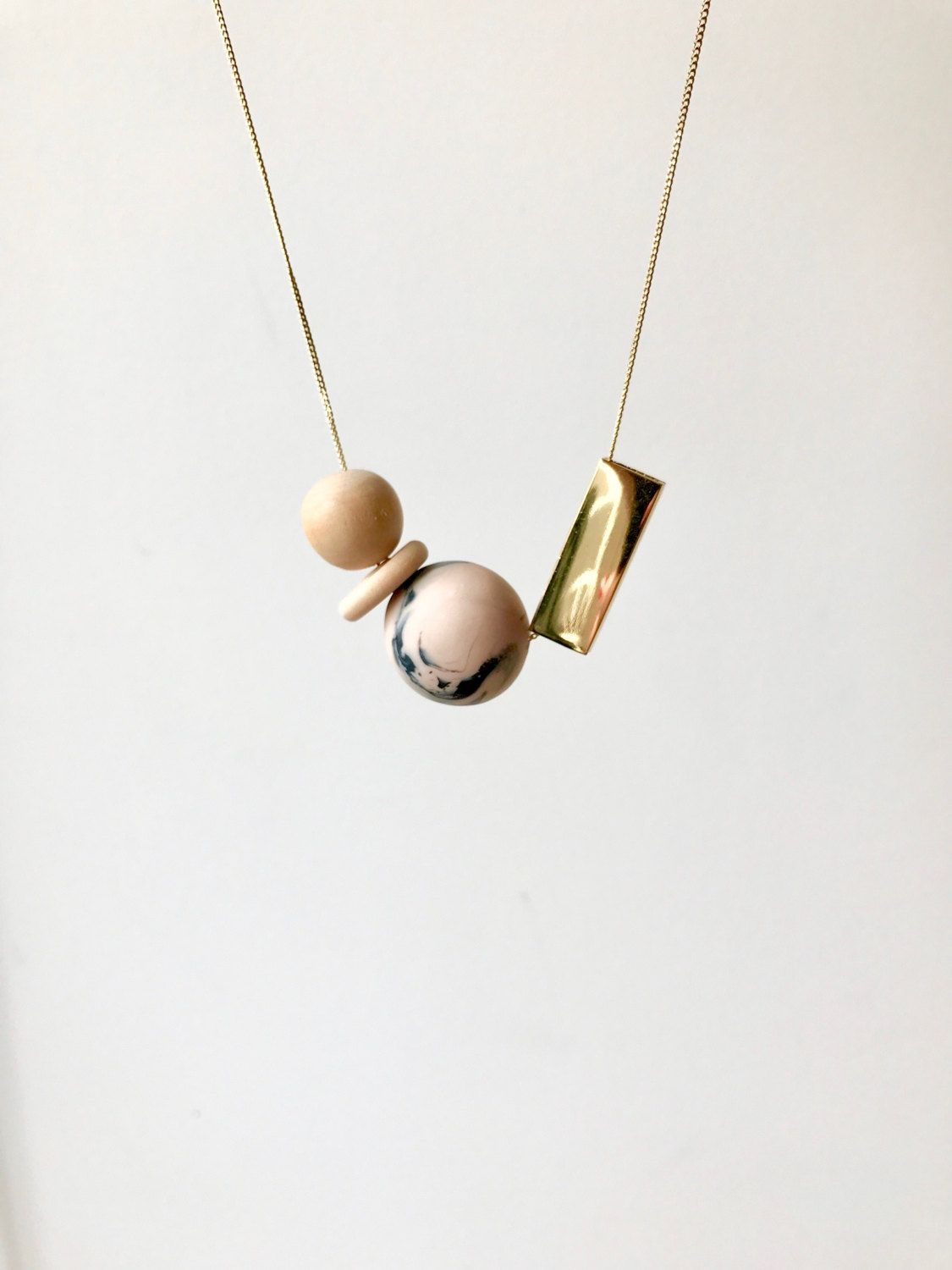 Blush minimalism | statement necklace from marbled black and peach polymer clay, wood and a gold bar by TheQuietObsession on Etsy