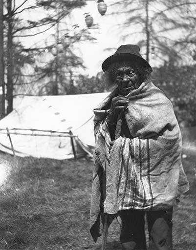 "Suquamish man known as ""Dominick"" Pousley, stands in front of tent, Seattle, Washington, July 28, 1903., UW Library American Indians of the Pacific Northwest Collection"