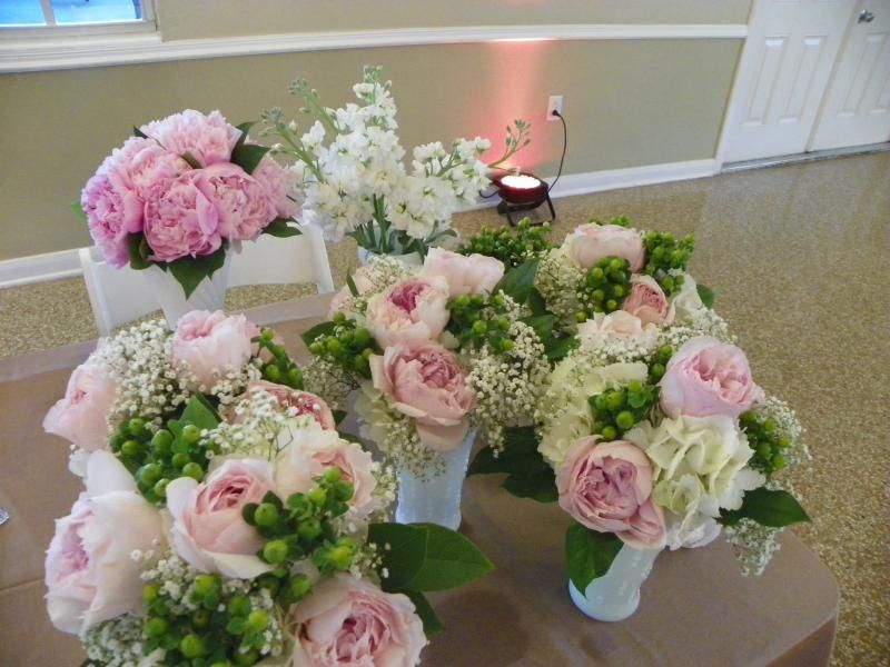 pink peonies, garden roses, hydrangea, baby's breath, and