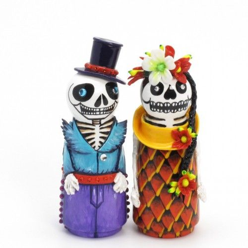 Dia de Los Muertes  my faves.... but not at $189.00 for a set of cake toppers made in Thailand....