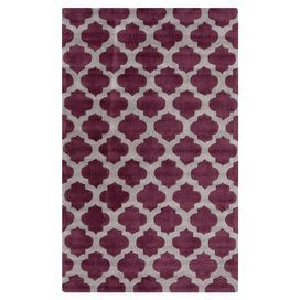 Hand-tufted rug with a quatrefoil trellis motif.    Product: RugConstruction Material: 100% PolyesterColor: Gray and violetFeatures: Hand-tufted Note: Please be aware that actual colors may vary from those shown on your screen. Accent rugs may also not show the entire pattern that the corresponding area rugs have.Cleaning and Care: Vacuum regularly with non-beater attachment. Blot stains immediately. Test cleaning products in discreet area. Dry clean.