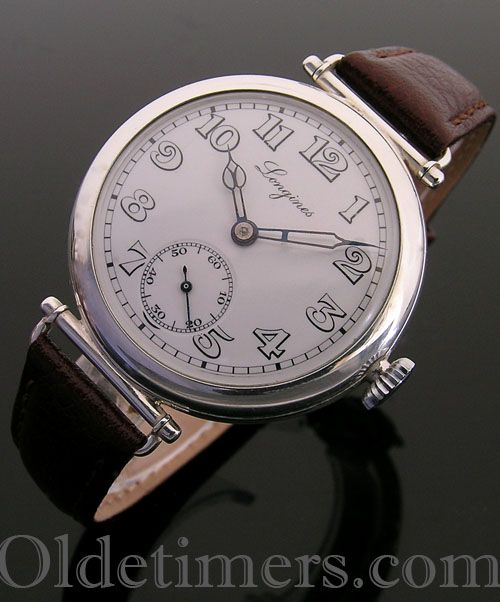 An early silver round vintage Longines watch, 1920s