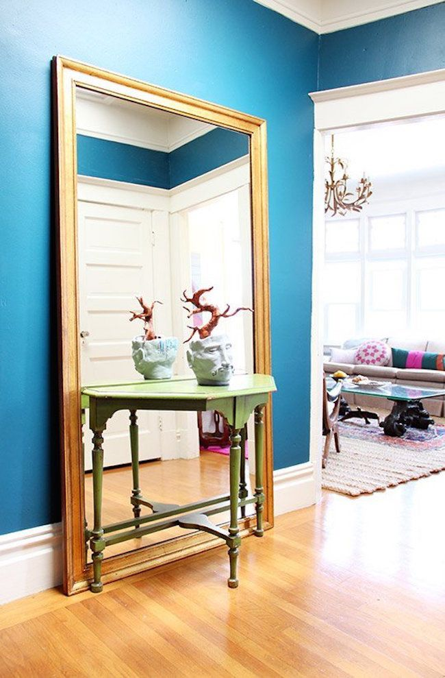 Large Full Length Mirror Behind A Small Entryway Table