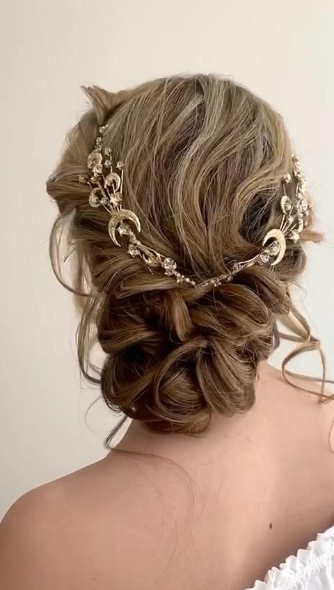 Boho curly bridal low bun hairstyle