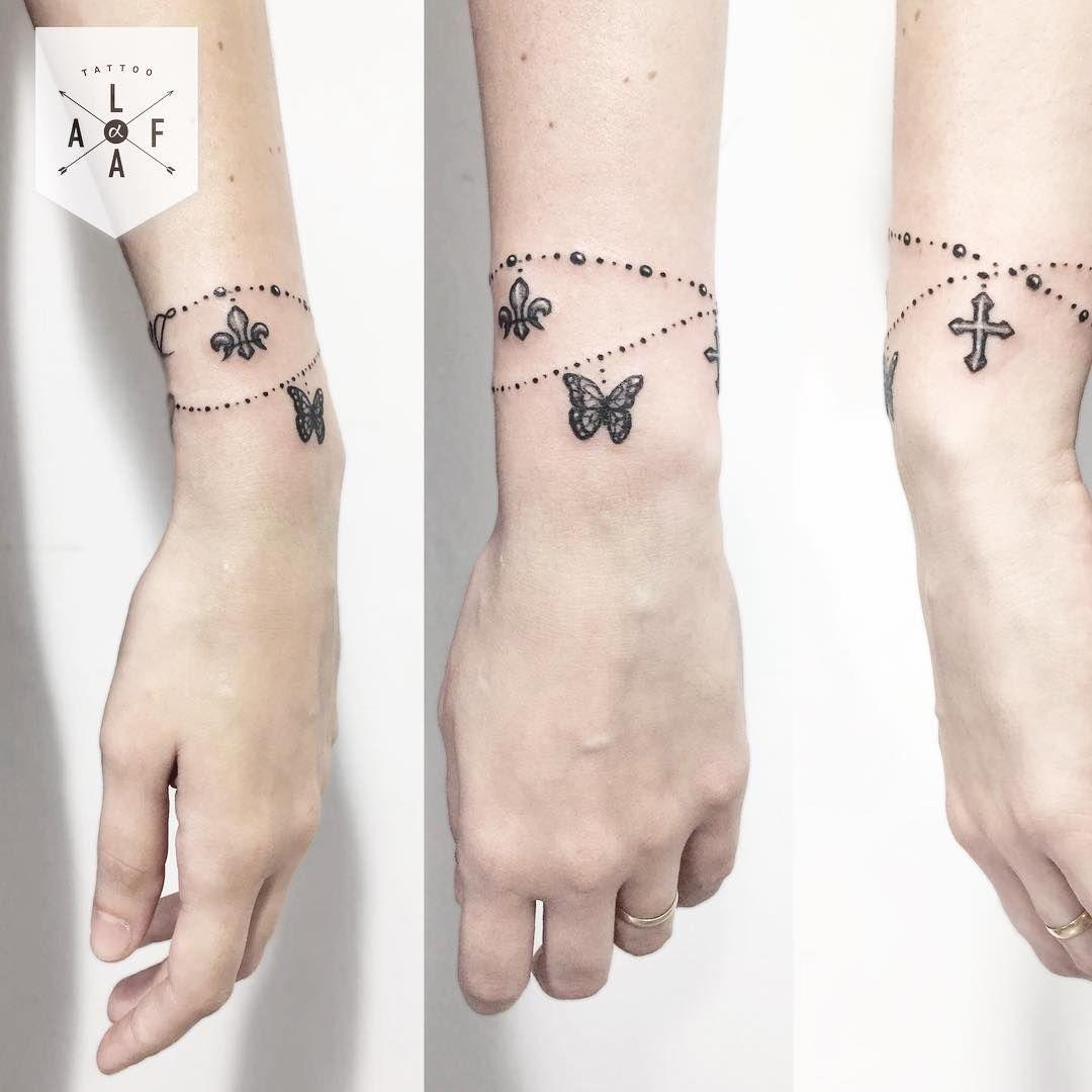 Butterfly And Cross Bracelet Tattoo Designs Wrist Bracelet Tattoo Wrist Tattoos For Women Arm Band Tattoo