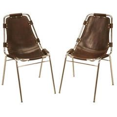 Pair of Chrome & Leather Charlotte Perriand Les Arcs Chairs c1960 | From a unique collection of antique and modern side chairs at https://www.1stdibs.com/furniture/seating/side-chairs/