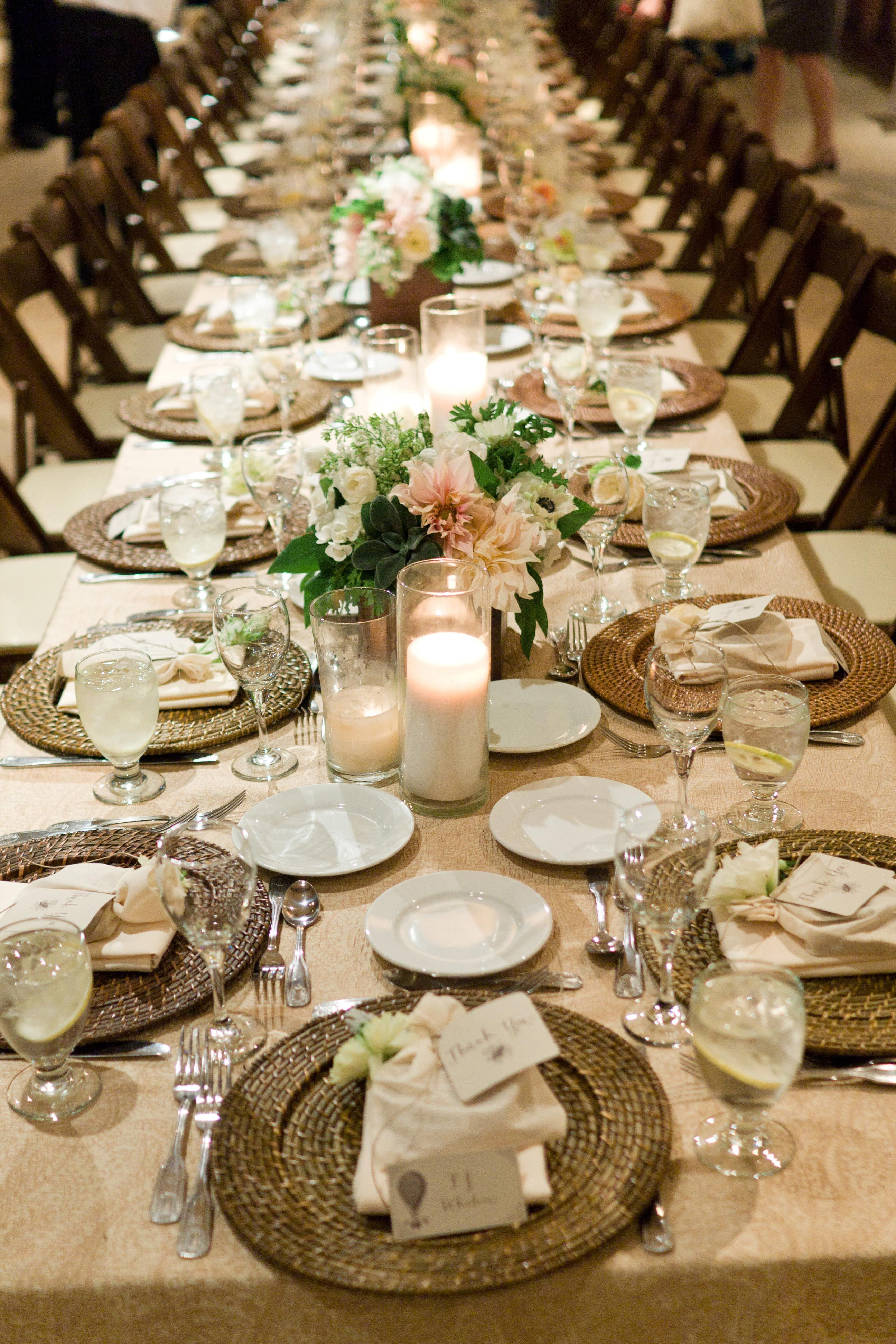 Down the middle of a long table low floral arrangements in shades of blush and ivory sat in square wooden holders alternated with glowing candles. & Rehearsal Dinner Romance: Celebrating Love at a Gorgeous Vineyard ...