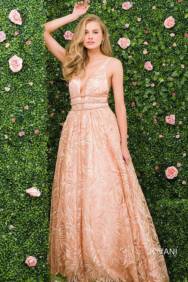 2e028fa54f2 Gorgeous floor length a-line rose gold embroidered prom gown features  sleeveless bodice with plunging neckline and open back.