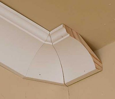 Crown moulding with a vaulted ceiling?-transition.jpg