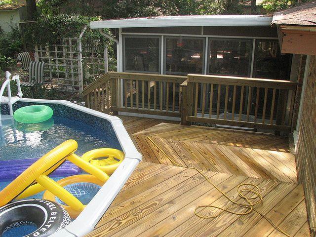 Wood Deck around above ground pool in Summerville, SC by Archadeck Charleston, via Flickr
