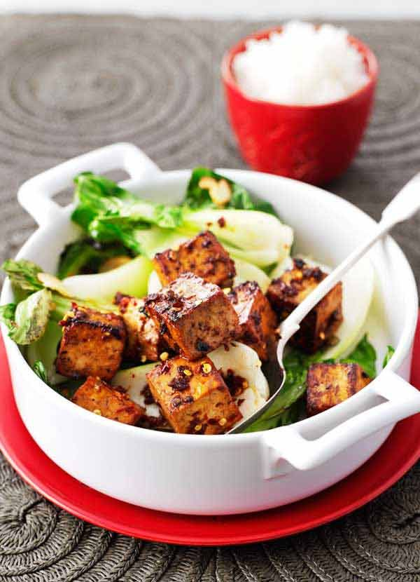 Add some oomph to tofu with a sticky ginger marinade. This simple recipe is quick to make and perfect served with pak choi on a bed of jasmine rice.