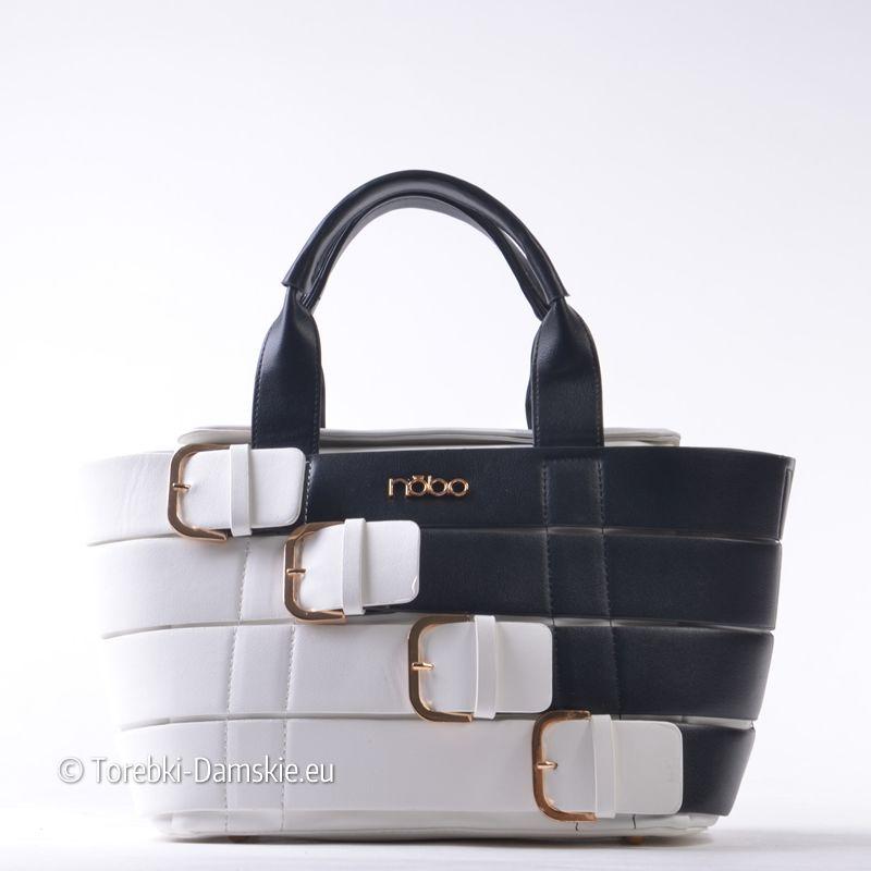 a491c04c39c07 Ekskluzywna czarno-biała torebka damska z nowej kolekcji. Cztery ozdobne  klamry z przodu.