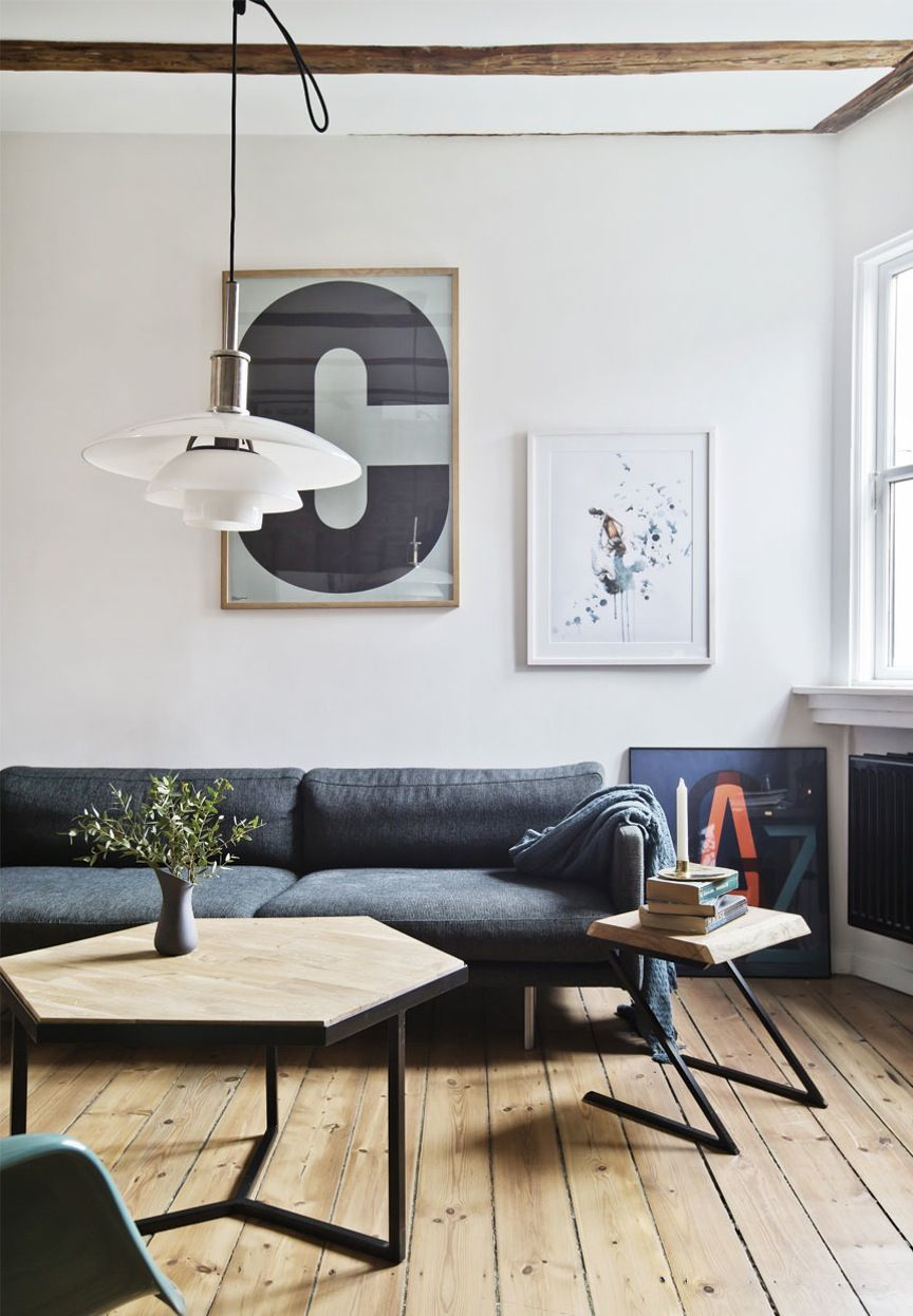 Minimal and nordic living room area with graphic posters, a grey ...