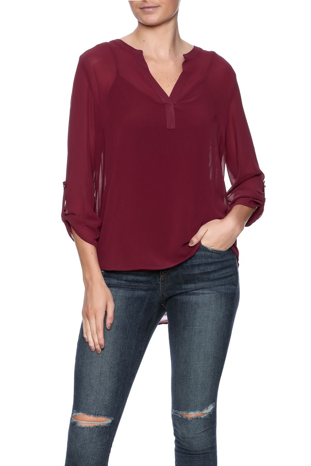 Sheer long sleeved top with cami top for lining underneath. Features a notched neckline and button tab sleeves.   Stacy Top by Daniel Rainn. Clothing - Tops - Blouses & Shirts Clothing - Tops - Long Sleeve Dallas, Texas Austin, Texas Marina, San Francisco