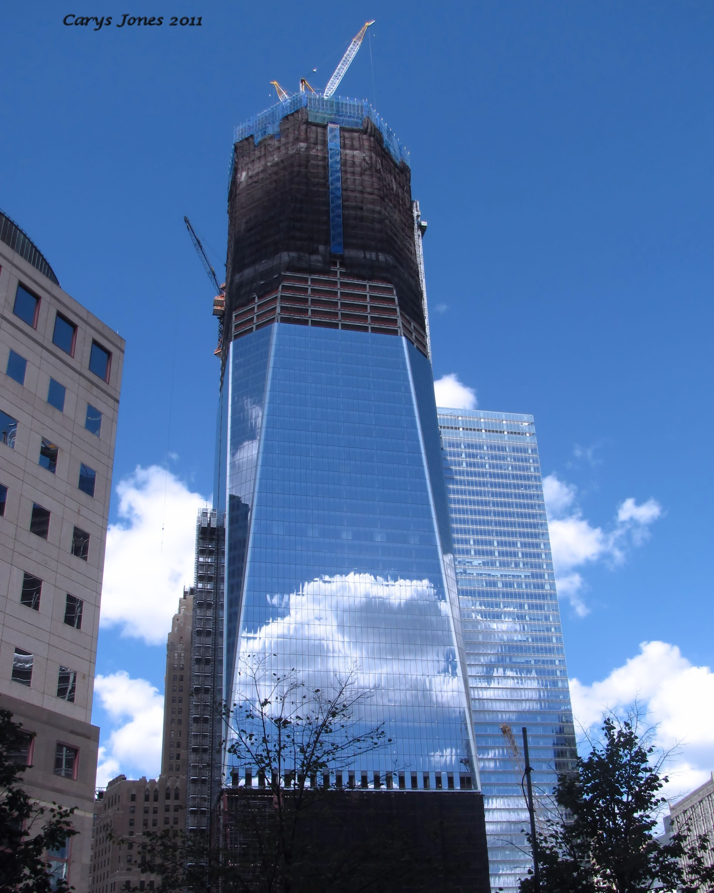 Freedom Tower under construction. Love the reflection in ...