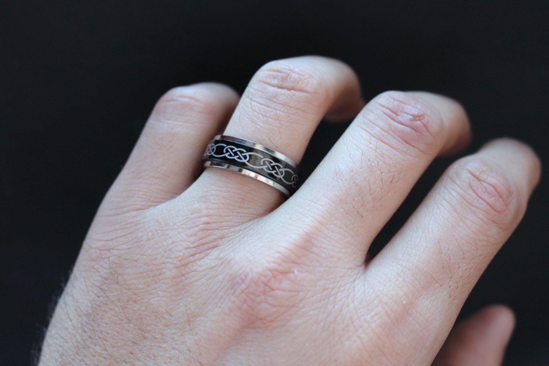 """""""This is beautiful stainless steel band with a Celtic Knot design. The band is perfect for showcasing the Celtic symbol of Eternity. Since this ring is unisex and has a great variance in ring sizes, it is the perfect option for matching couples rings. We offer two rings bought together with a £5 discount. If you would like a set of two matching rings in different sizes, please select \""""Set of 2 Rings\"""" and select your size. Since you can only select one size at a time, please put a note at check"""