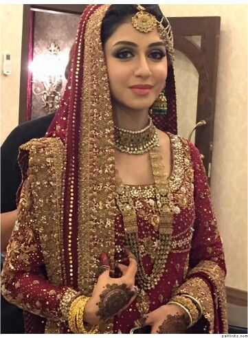 17385cb445 Pakistani bridal look. Nice color and Border, the rest is too much. It  could use a little toning down