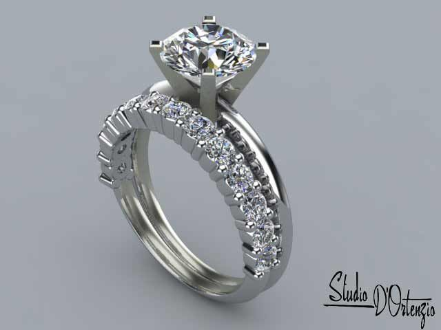 Simple but Not a cookie cutter stock wedding ring. Matching the tapper, and shank style of the engagement ring, makes it a well tailored suit.