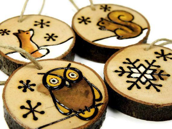 I wood burned these woodland animal ornaments by hand on slices of dogwood…
