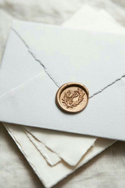 Gold Monogrammed Wax Seal On Torn Edge Envelopes