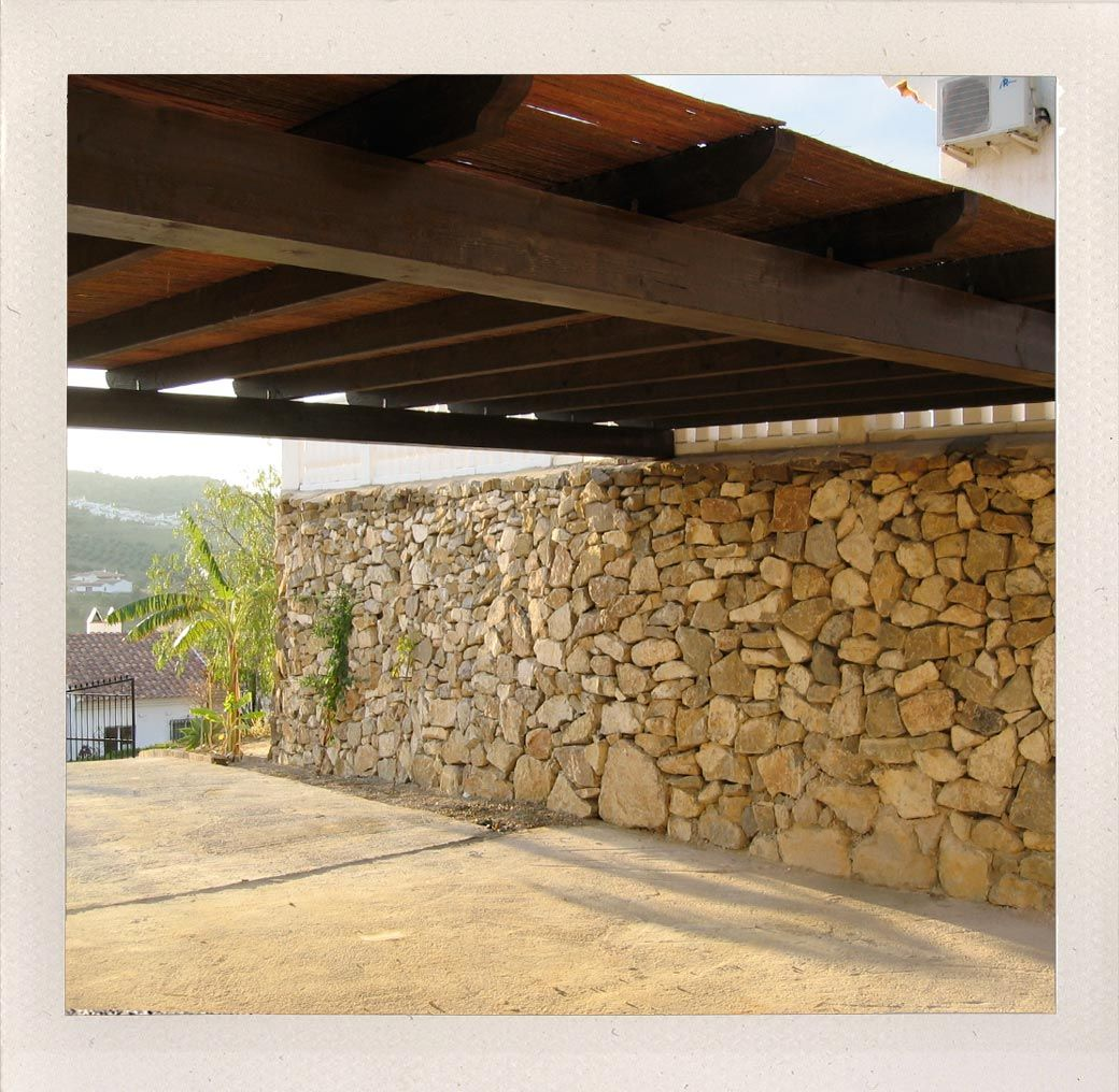 carport ideas, stacked fieldstone wall, timber truss roof