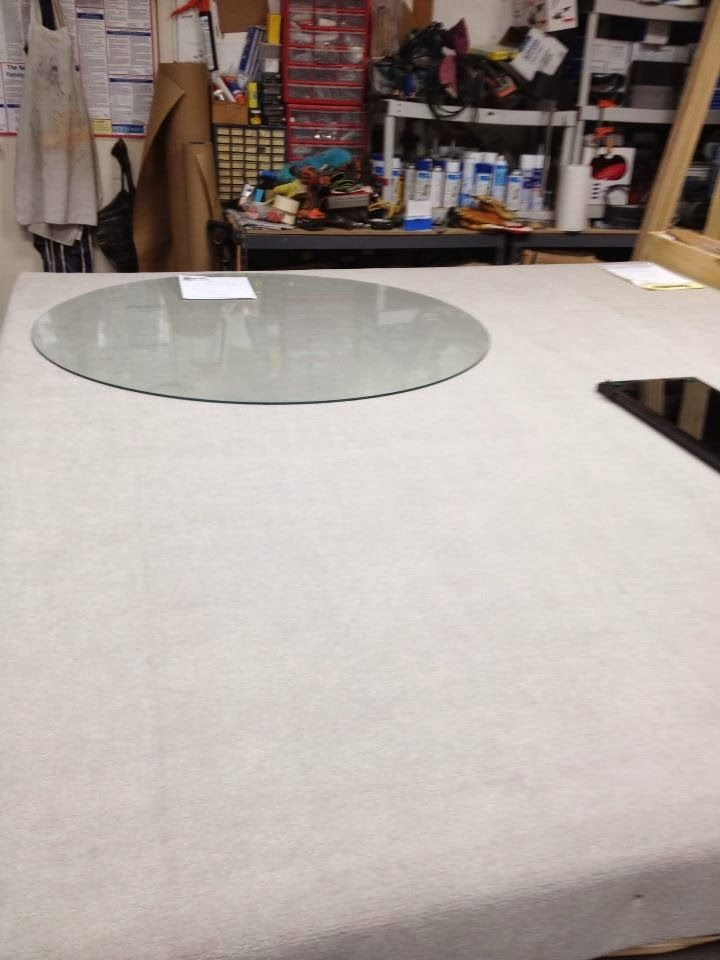 The picture you see is a GLASS cutting table at SHOWERMAN , the ...