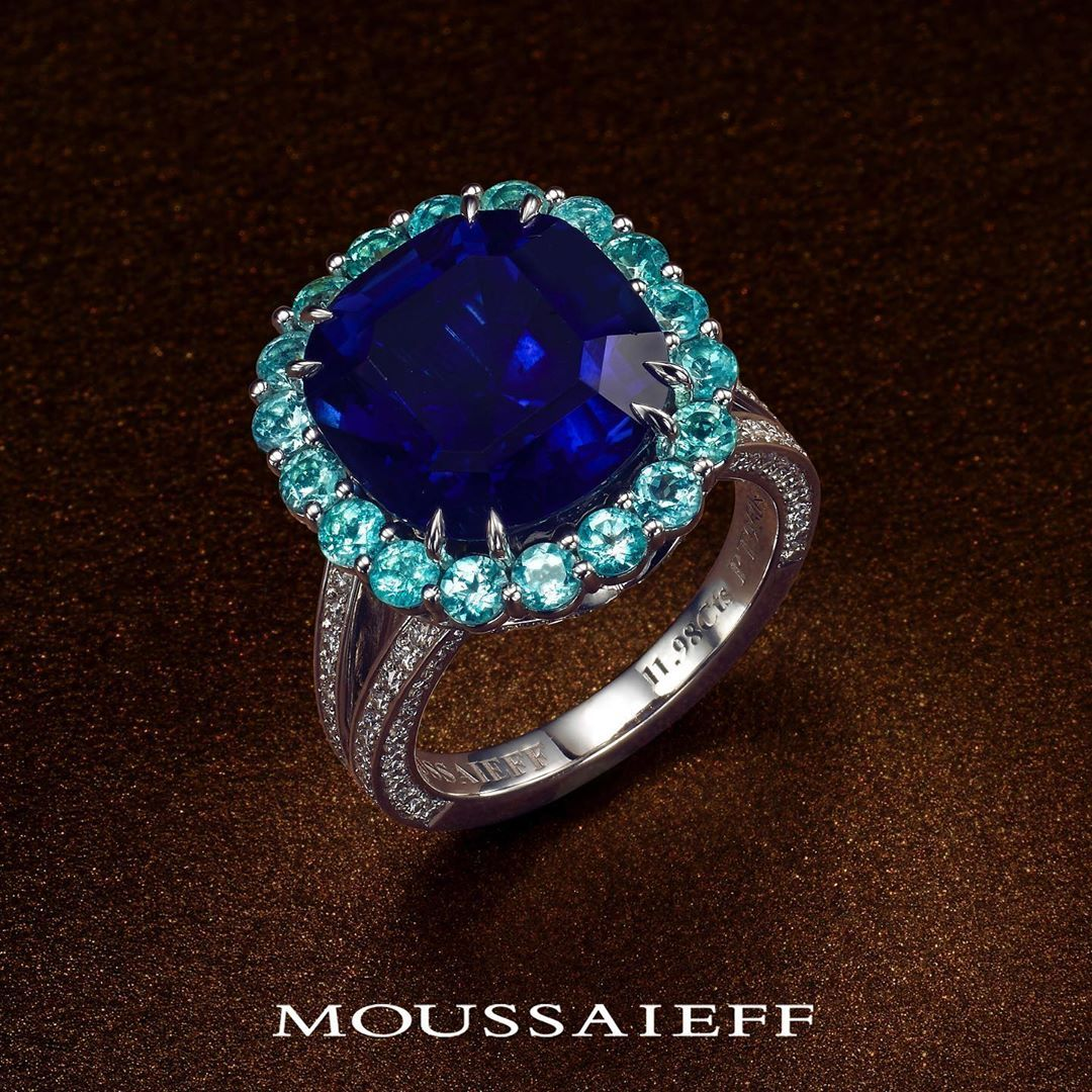 Mystic Blue Be Entranced By Our Exceptionally Rare 12 Carat Sapphire And Paraiba Tourmaline Paraiba Tourmaline Ring Tourmaline Ring Beautiful Rings
