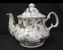 'Chintz White Rose' Teapot - One look at this larger variety fine bone china teapot will take your breathe away! You can see the many white roses in bloom with the forming buds of many others to come. That helps to symbolize the longevity of this teapot. It will be blossoming at the beginning and help to form many new …