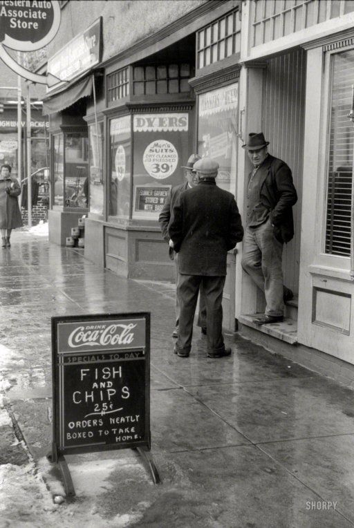 """November 1940. """"Men outside of a beer parlor in Jewett City, Connecticut."""" 35mm nitrate negative by Jack Delano."""