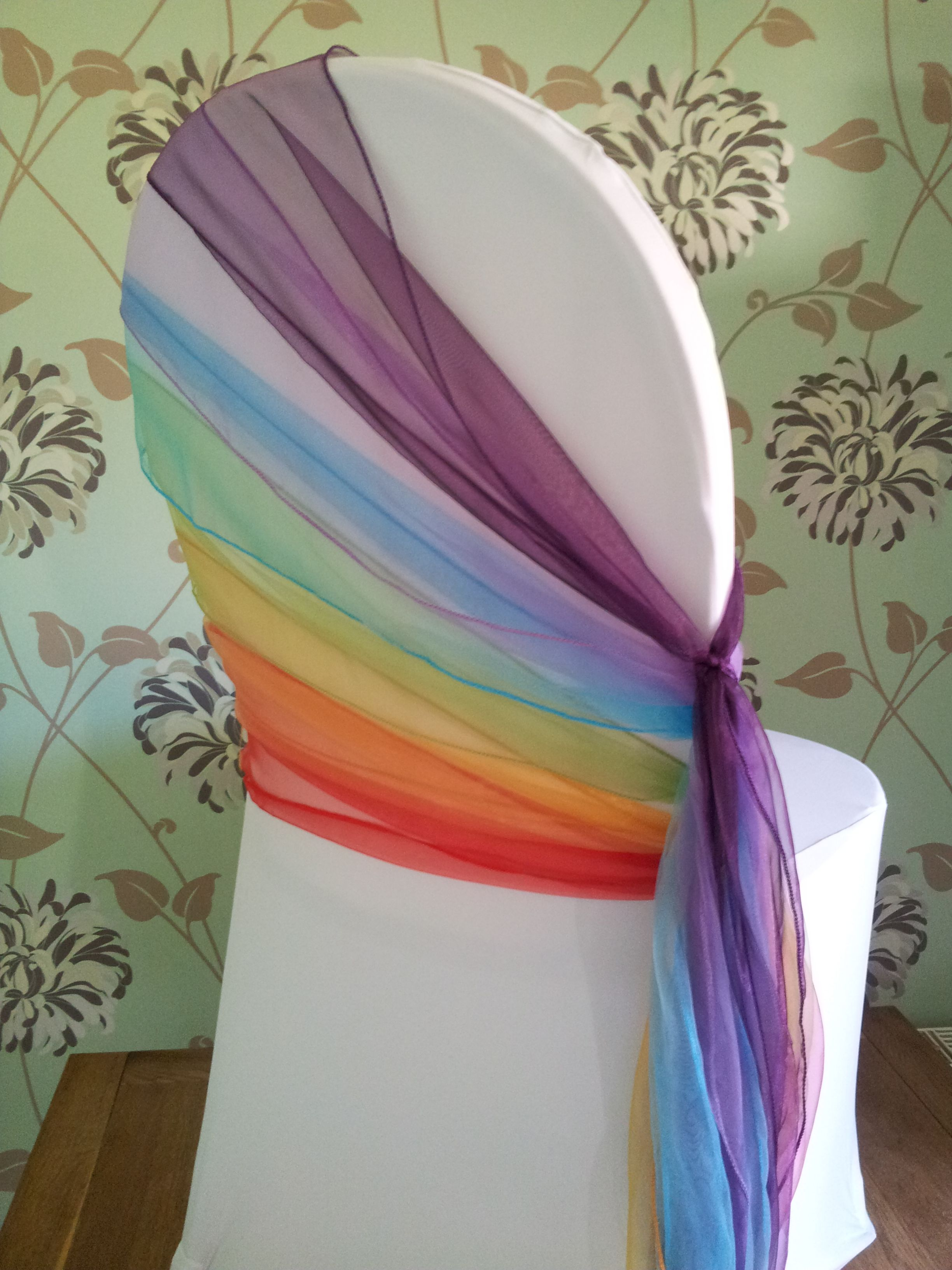 Adding A Rainbow Of Coloured Tulle To Reception Chairs Is Such A