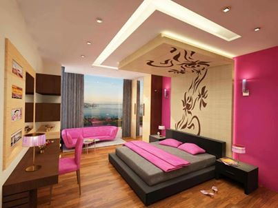 this is a typical girls bedroom with a lot of pink colour and a nice couch for her to relax on