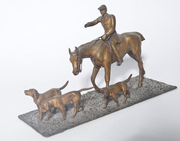 Mounted Hunter with Three Hounds