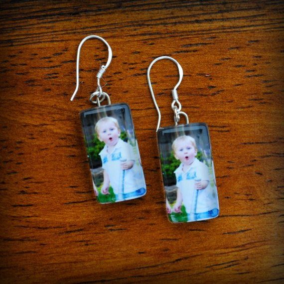 I want these...perfect for twin moms..a pic of each kid on each ear.