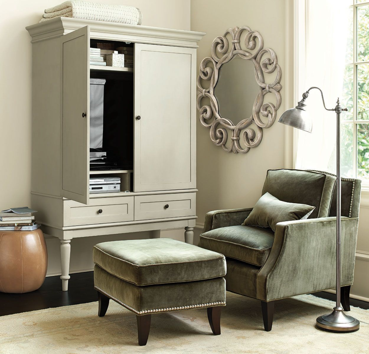 We love the way our Marais Media Armoire hides all your pesky electronics but still feels  light because of it's leggy frame.