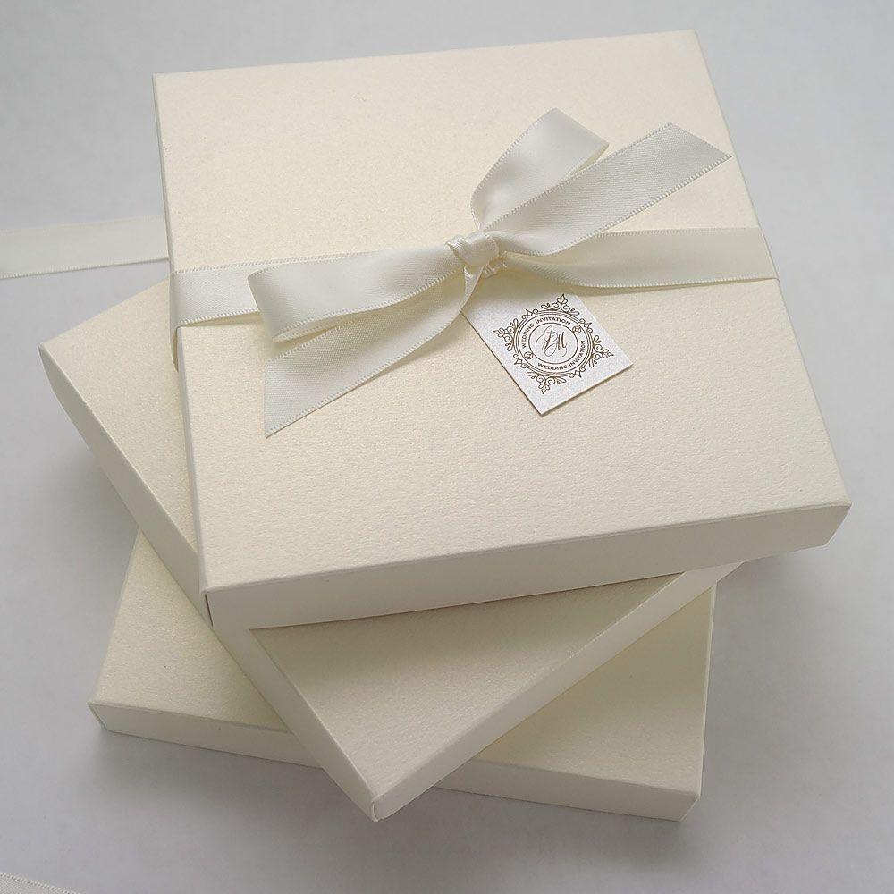 Ivory invitation box tied with a satin ribbon | Wedding Invitations ...