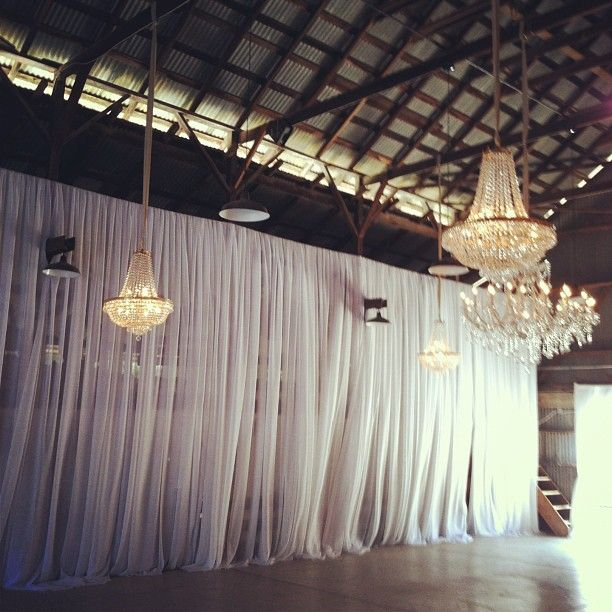 Draping Wall And Chandeliers Clever Way To Disguise Ugly Walls For