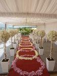 Love the arrangements linning the aisle