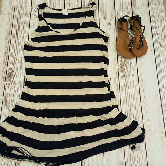 NWOT Navy and cream striped dress Navy and cream striped dress with ruffled bottom. About 37 inches from shoulder to hem.perfect lounging by the cabana dress.  Fabric Content: 52% Polyester  41% Rayon 7% Linen Newport Dresses Midi