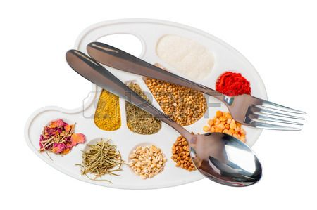 tablewares and a palette of spices and groceries Stock Photo