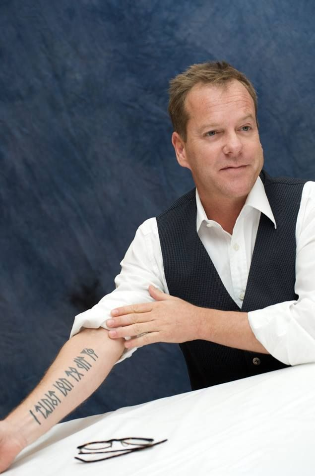 Keifer Sutherland\'s tattoo in Younger Futhark runes reads: \