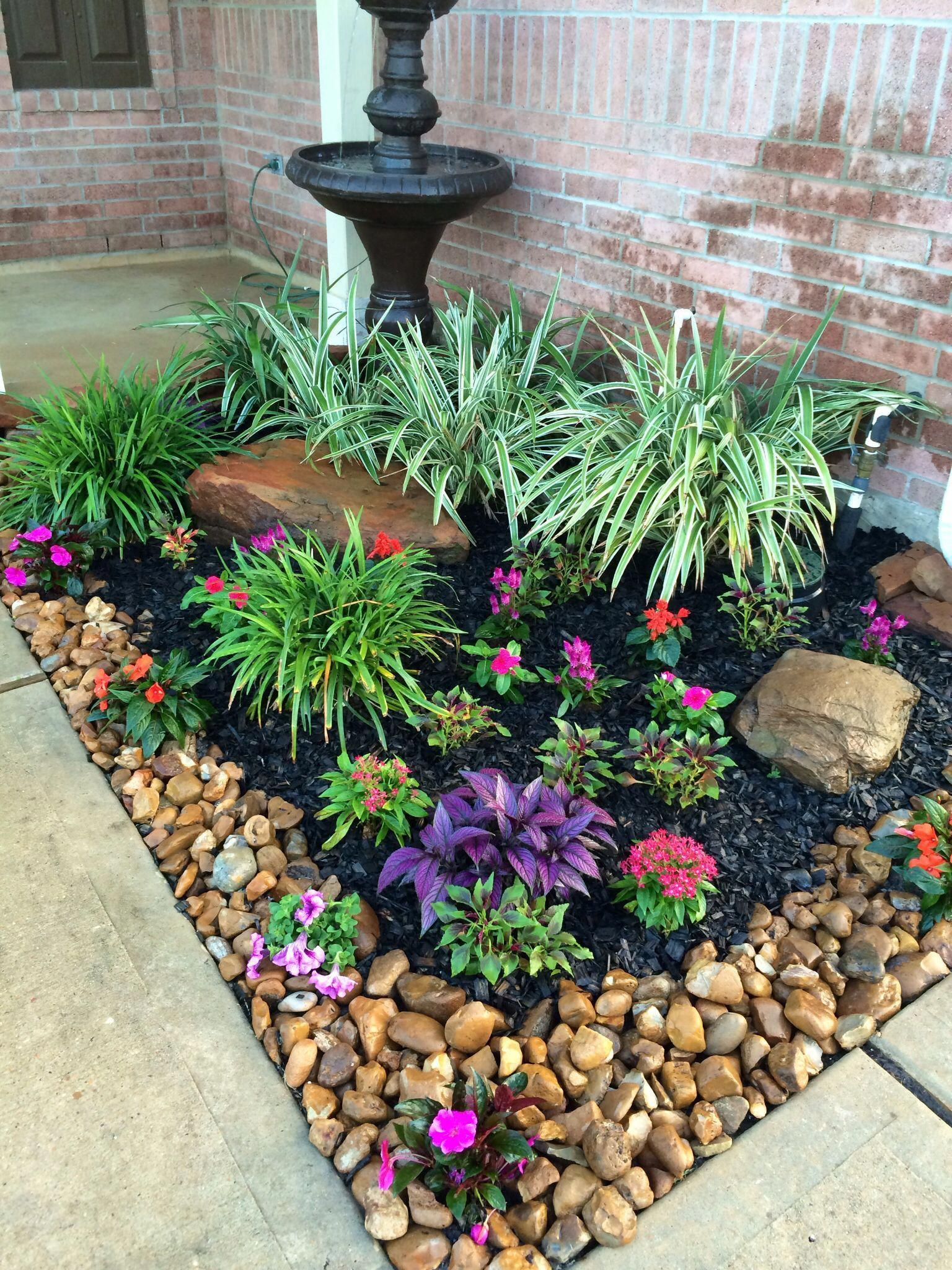 Behind The Weather Gets Warm A Smattering Of Flowers And Flora And Fauna Gives Stone Flower Beds Small Front Yard Landscaping Front Yard Landscaping Design